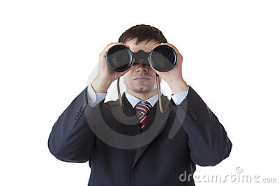 Young manager looks through binoculars