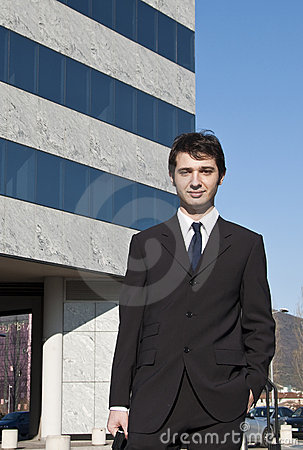 Young manager and skyscraper