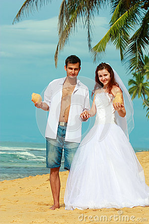 Young married couple on a beach in a tropical destination