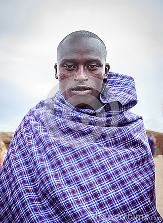 Young Masai acting for me to take picture Editorial Stock Image
