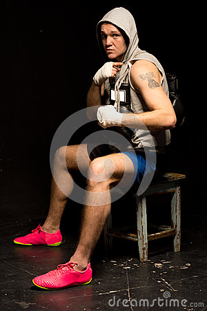 Young mean looking boxer waiting for a fight