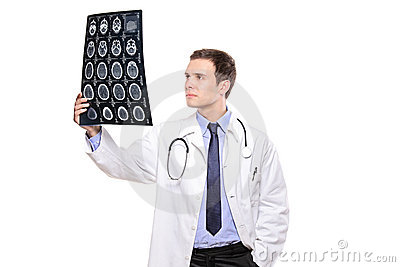 A young medical doctor analyzing a CT scan