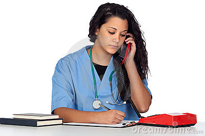 Young medical student with a phone