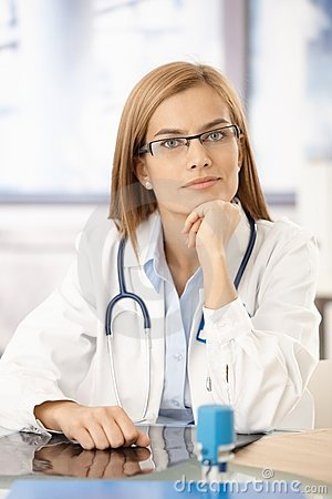 Young medical student sitting at desk in office