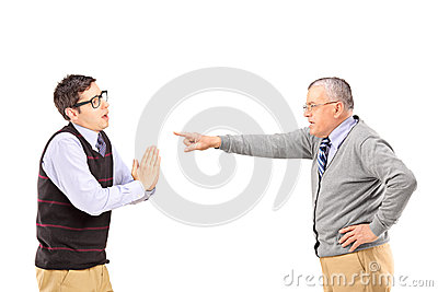 Young man begging and angry mature man gesturing with finger