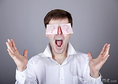 Young men with notes on eyes.