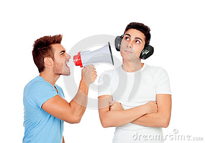 Young men screams to his friend through a megaphone