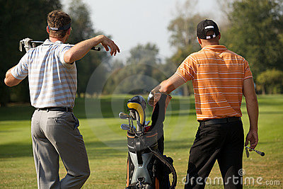 Young men standing in golf course