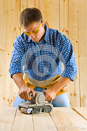 Young Men Works With Detail Sander Stock Image - Image: 26079711