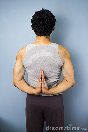 Young mixed race man in yoga pose