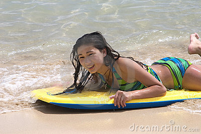 young model on a board in the ocean mr yes pr no 2 551 2