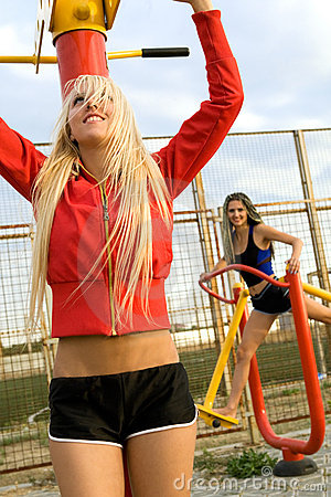 Young model working out on fitness playground