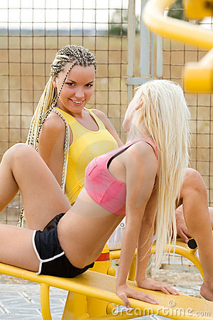 Young models working out on fitness playground