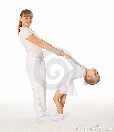 The young mom and her little daughter doing exerci