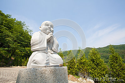 Young monk statue
