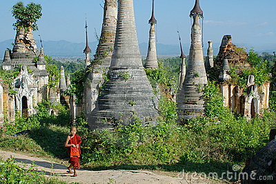 Young monk between stupas