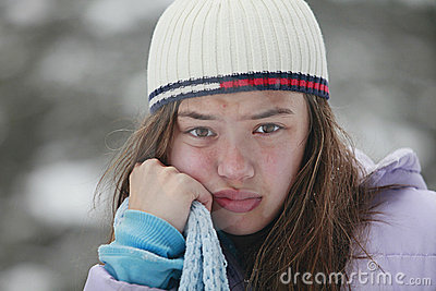 Young moody teenager in winter cold