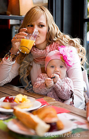 Free Young Mother And Baby Daughter Having Breakfast Stock Photography - 13730072
