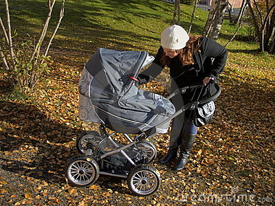 Young mother with baby carriage