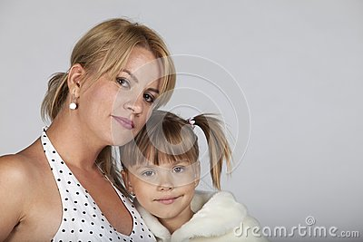 Young mother and daughter smiling