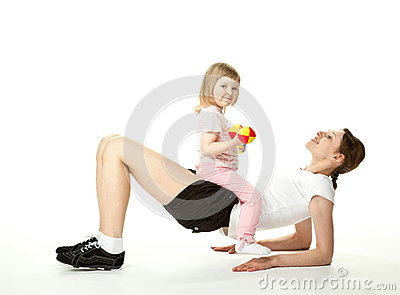 Young mother doing sport exercises with daughter