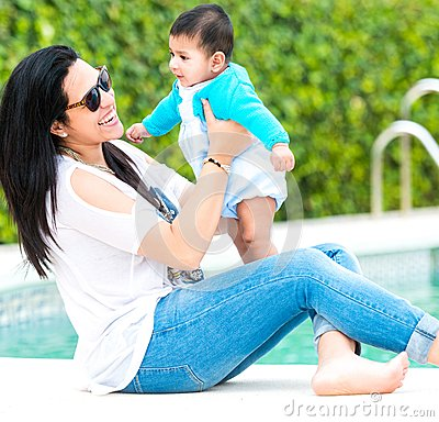 Young Mother With Her Baby Near The Swimming Pool Stock Photo Image 57401308