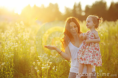 Young mother holding her adorable girl