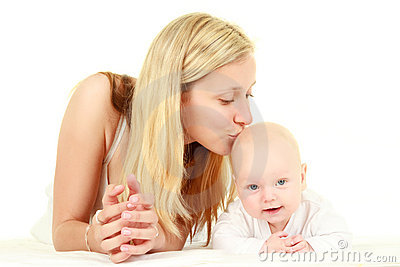 Young mother kissing baby
