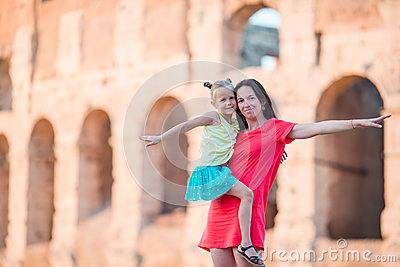 Young mother and little girl exploring Coliseum outside in Rome, Italy. Family portrait at famous places in Europe Stock Photo