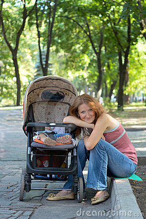 Young mother with perambulator