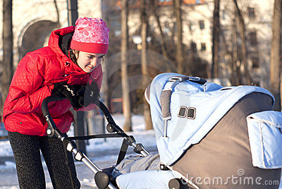 Young mother with a pram