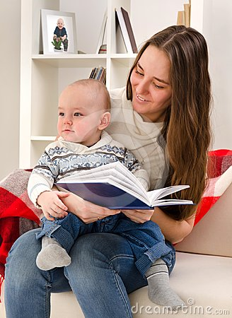 Young mother reads to the child the book