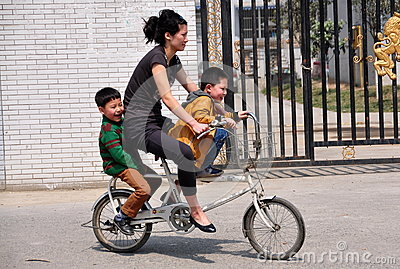 Pengzhou, China: Mother and Sons on Bicycle Editorial Photo