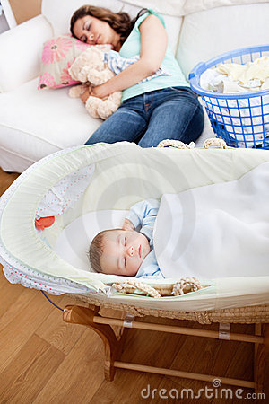 Free Young Mother Sleeping On The Sofa With Her Baby Stock Image - 16262881