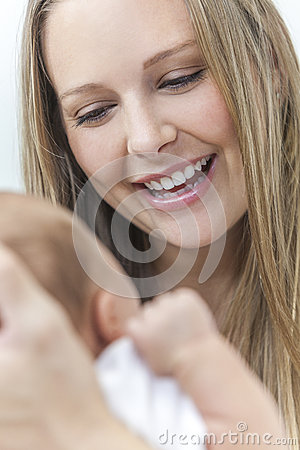 Young Mother Smiling at Her New Baby