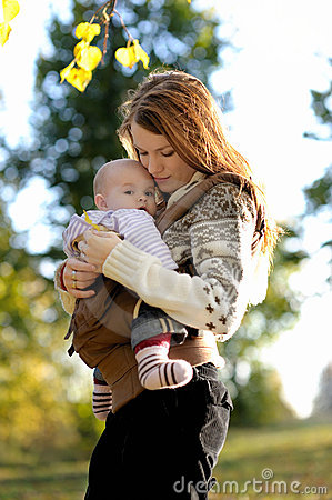 Free Young Mother With Her Baby In A Carrier Stock Photography - 11297482