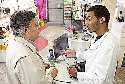 Young Mulatto male pharmacist speaking with a customer