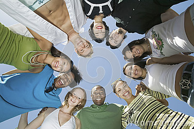 Young Multiethnic Friends Forming A Circle