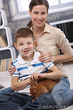 Young mum and son with pet rabbit