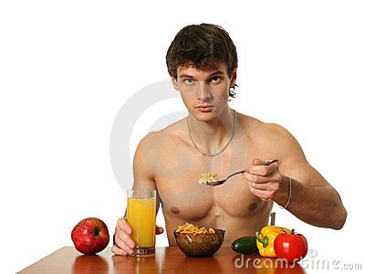 Young Muscular Man Eating His Breakfast