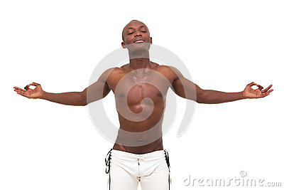 Young muscular man meditating