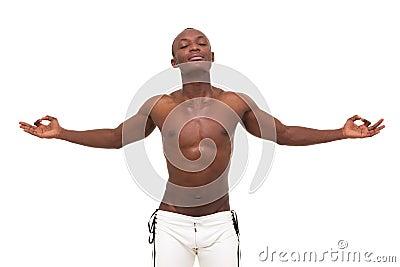 Young muscular man meditating