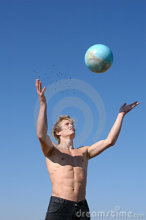 Young Muscular Man Playing with a Globe