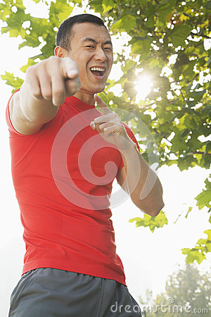 Free Young Muscular Man Pointing At Camera Stock Image - 31689171