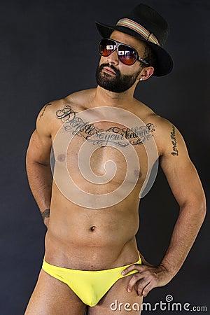 Young muscular man in Swimwear