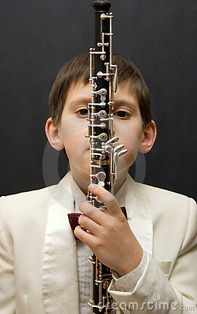 Free Young Musician With Oboe Stock Image - 7005241