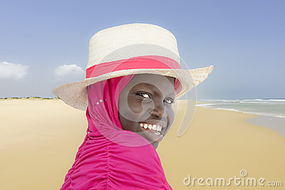 Young Muslim girl at the beach, ten years old Stock Photo