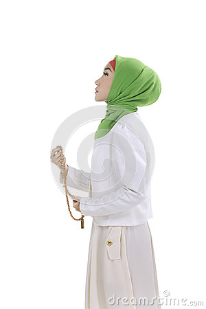 Free Young Muslim Woman Holding Prayer Beads Stock Images - 71895684