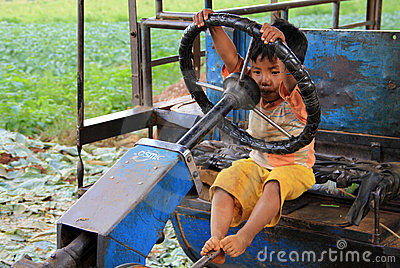 Young Myanmar child play to drive Editorial Photography
