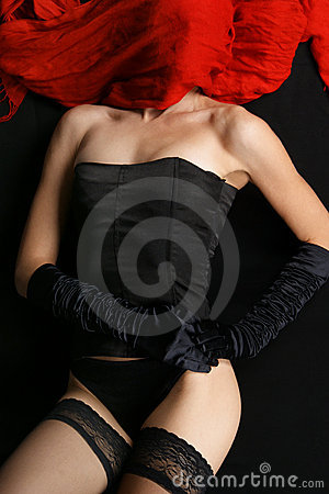 A young and mystique lady in black erotic lingerie
